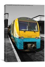 An Arriva train leaving Colwyn bay station., Canvas Print