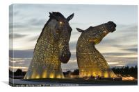 Kelpies at dusk floodlit in Yellow., Canvas Print