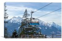 Ski lift with the snowy mountain in the background, Canvas Print
