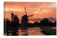 Group of duck flying over a windmill at the warm a, Canvas Print
