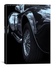 side view of the exhaust and wheels of a rare Vint, Canvas Print