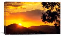 Sunset sun behind the mountain with orange sky, Canvas Print