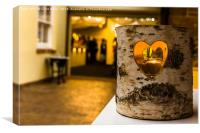 Heart cut into a log with candle inside., Canvas Print