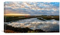 Sunrise over the quay or staithe at Thornham in N, Canvas Print