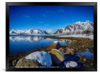Snowy boulders at the edge of the fjord, Lofoten , Framed Print