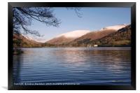 Grasmere with snow capped fells in the background., Framed Print