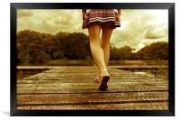 Lady with a perfect figure walking on a jetty, Framed Print
