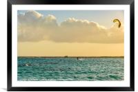 A man practices kitesurfing at sunset, Framed Mounted Print