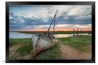 Sunrise over abandoned fishing boat on the shore a, Framed Print