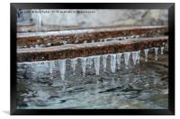 Icicles formed above a traditional water tank, Framed Print
