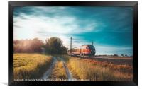 High-speed train moving through nature at sunset, Framed Print