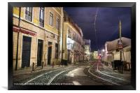 An old stone street in Lisbon at night., Framed Print