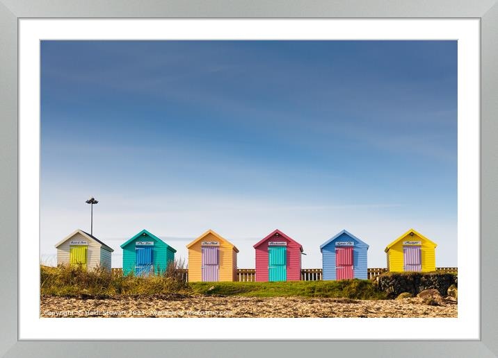 Buy Framed Mounted Prints of Colourful Beach Huts at Amble by Heidi Stewart