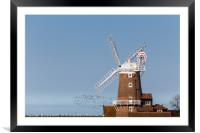 Flock of birds take to the skies behind Cley windm, Framed Mounted Print