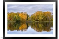 The lake, reflecting the cloudy sky and autumnal f, Framed Mounted Print