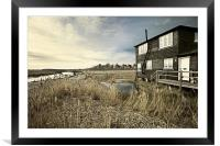 Black wooden house overlooking a stream, Framed Mounted Print