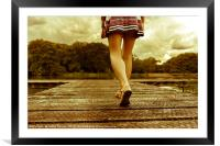 Lady with a perfect figure walking on a jetty, Framed Mounted Print