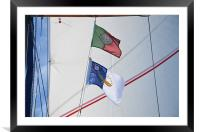 Courtesy flags against sail, Framed Mounted Print